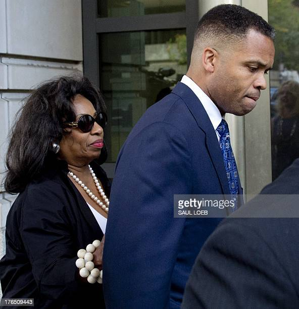 Former Illinois Congressman Jesse Jackson Jr walks with his mother Jacqueline lavinia Brown as he leaves the US District Court in Washington DC...