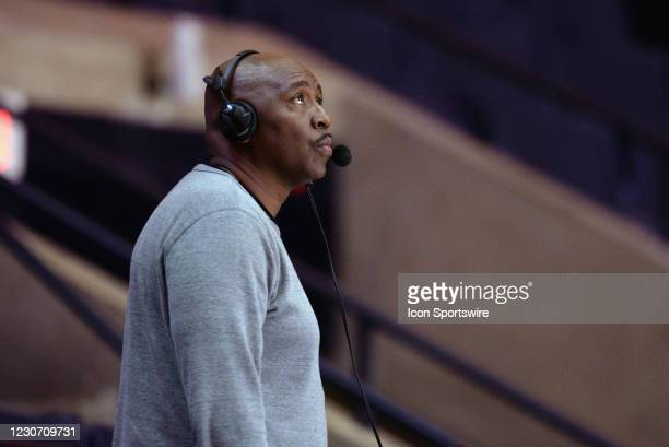 Former Illinois Fighting Illini player and current radio broadcaster Deon Thomas looks on during the Big Ten Conference college basketball game...