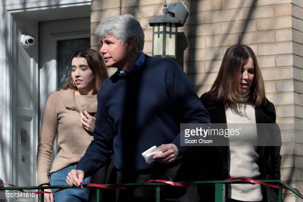 Former Illinois Governor Rod Blagojevich greets people gathered in front of his home as he steps out with his daughter Amy and wife Patti to address...