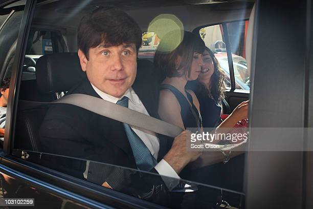Former Illinois Governor Rod Blagojevich leaves court with his wife Patti and daughter Amy July 26 2010 in Chicago Illinois Lawyers gave their...