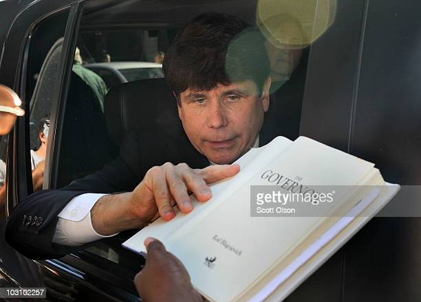 Former Illinois Governor Rod Blagojevich signs a copy of his book The Governor as he leaves court July 26 2010 in Chicago Illinois Lawyers gave their...