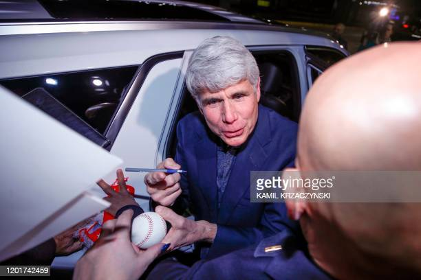 Former Illinois governor Rod Blagojevich signs authographs upon his arrival at O'Hare International Airport after being released from prison on...