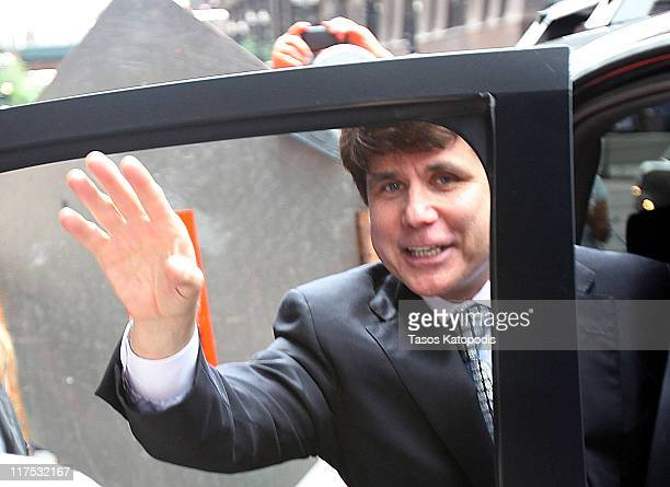 Former Illinois Governor Rod Blagojevich waves as he leaves following a guilty verdict in his corruption retrial at the Dirksen Federal Courthouse...
