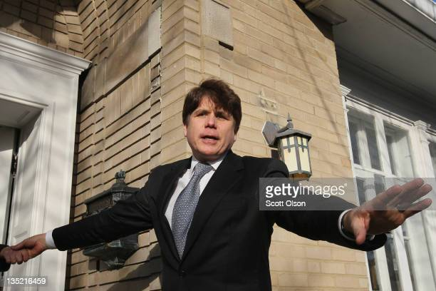 Former Illinois Governor Rod Blagojevich waves to supporters outside his home after returning from his sentencing hearing December 7 2011 in Chicago...