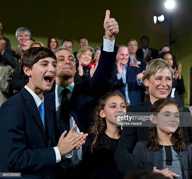 Former Illinois US Congressman and White House Chief of Staff Rahm Emanuel is surrounded by his family son Zach daughters Lea and Ilana and his wife...