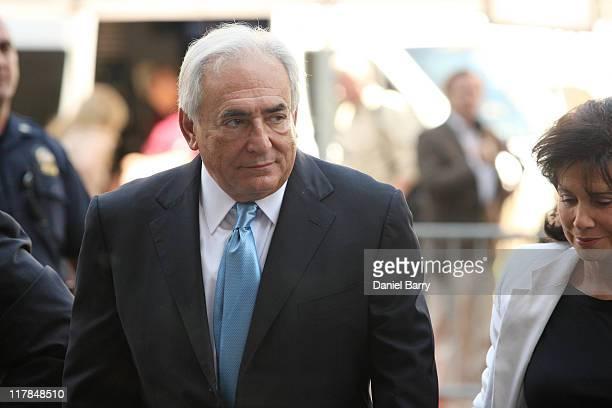 Former IMF Chief Dominique StraussKahn and wife Anne Sinclair arrive New York State Supreme Court for a hearing July 1 2011 in New York City...