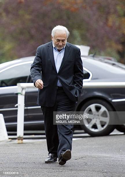 Former IMF chief Dominique StraussKahn arrives at a polling station for the Socialist party's 2011 primary vote for the 2012 French presidential...