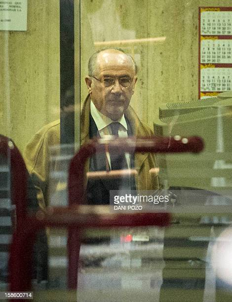 Former IMF chief Rodrigo Rato arrives at Spain's National Court in Madrid on December 20 2012 Rato faces charges linked to the collapse of Spanish...