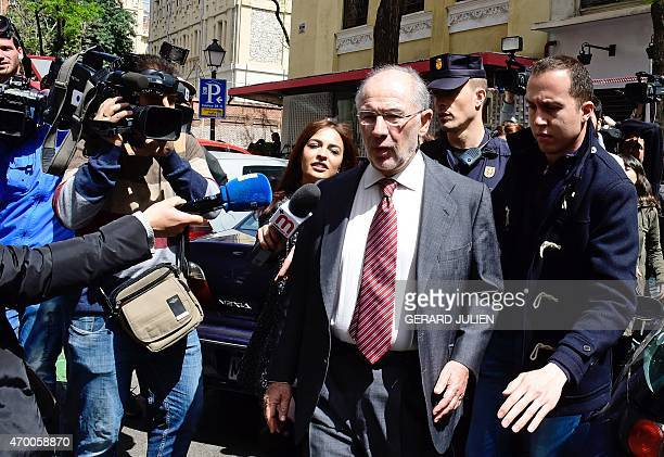Former IMF head and former Spanish Economy minister Rodrigo Rato is surrounded by the media as he leaves his office on April 17 2015 in Madrid...