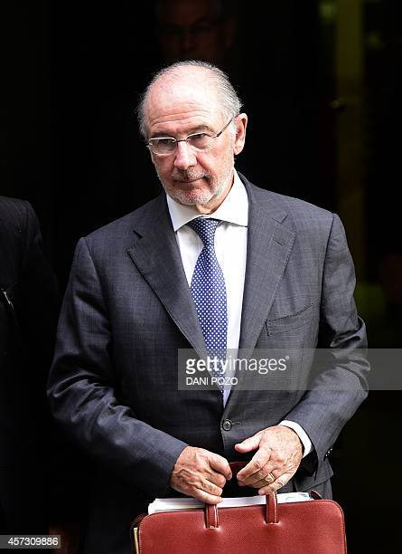 Former IMF head Rodrigo Rato leaves a hearing in Madrid on October 16 2014 accused of spending sprees with a company credit card while he was chief...