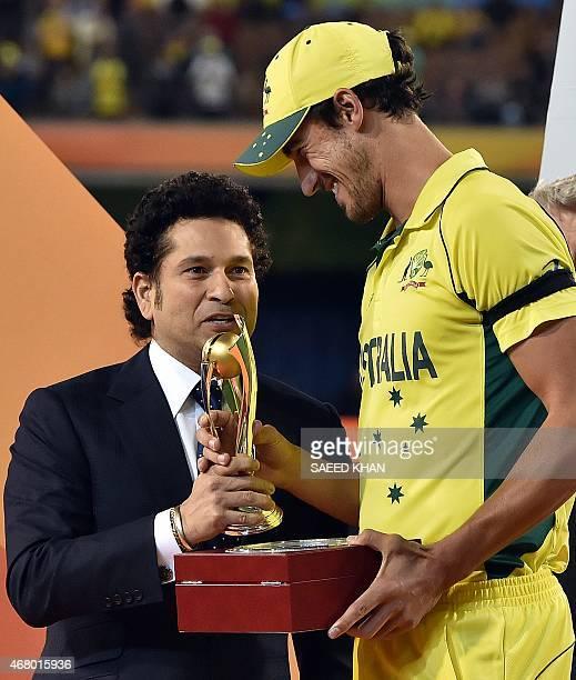 Former India batsman Sachin Tendulkar presents the Man of the Series award to Australia's paceman Mitchell Starc after the 2015 Cricket World Cup...