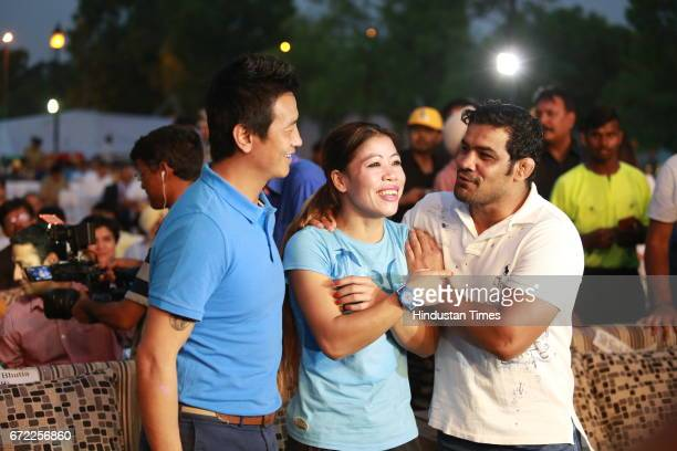 Former India football skipper Bhaichung Bhutia fivetime World Champion boxer Mary Kom and Olympic double medallist Sushil Singh during the launch of...
