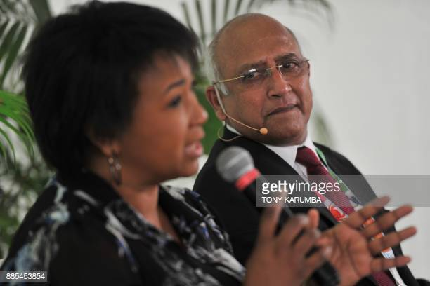 Former Indian Air Force pilot Rakesh Sharma listens as US astronaut Mae Carol Jemison speaks during a press conference on the sidelines of the...