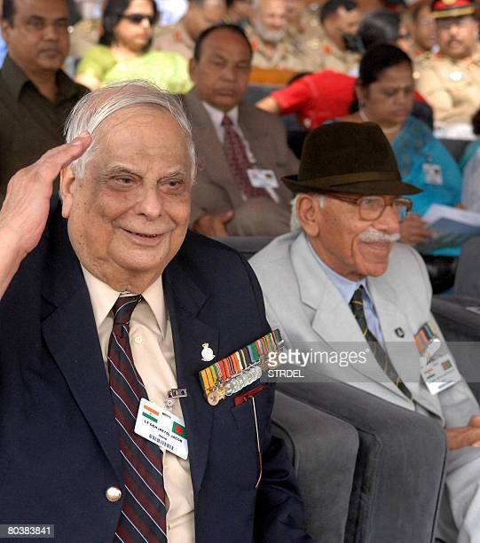 Former Indian Army soldier LieutenantGeneral Jacob salutes as he sits with fellow veterans during an Independence Day celebration ceremony at The...