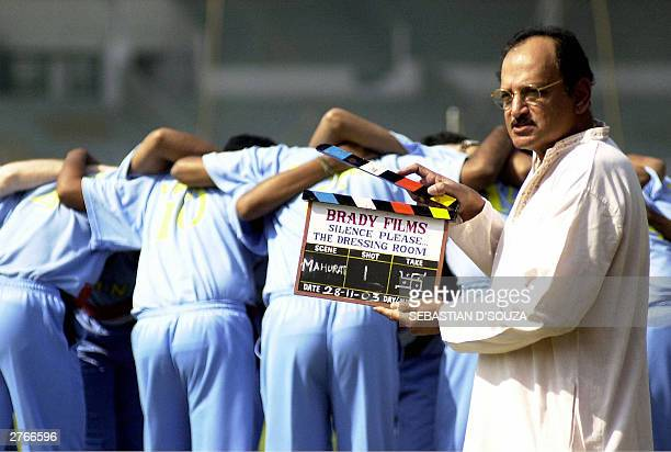 Former Indian cricket captain Ajit Wadekar stands poised with a clapper board at the Muhurat of the film 'Silence PleaseThe Dressing Room' at the...