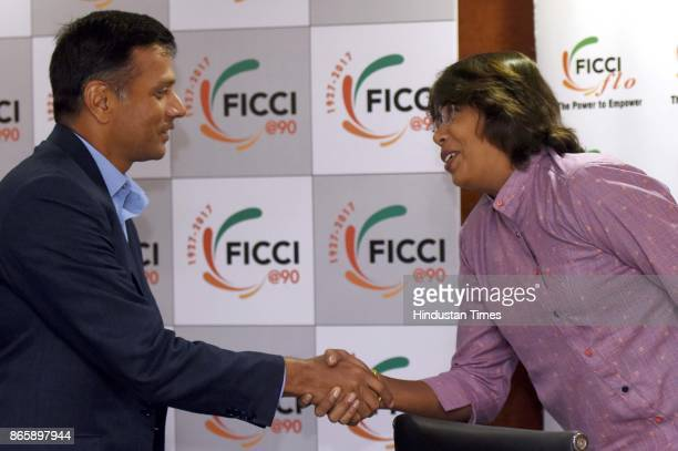 Former Indian Cricket Captain Rahul Dravid shakes hands with fast bowler Indian Womens Cricket Team Jhulan Goswami during the FICCI Ladies...