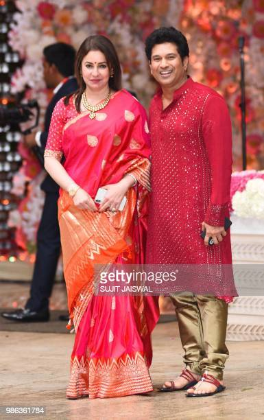 Former Indian cricket captain Sachin Tendulkar and his wife Anjali arrive for the preengagement party of India's richest man and Reliance Industries...