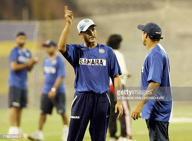 Former Indian cricket captain Sourav Ganguly takes some tips from Indian fielding coach Robin Singh during a practice session at the Eden Garden...