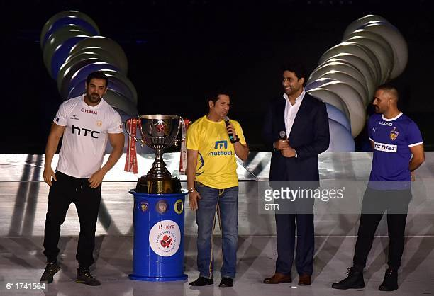 Former Indian cricketer and Kerala Blasters FC coowner Sachin Tendulkar speaks as Indian cricketer and Chennaiyin FC coowner Mahendra Singh Dhoni and...