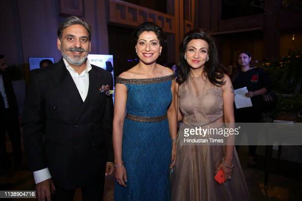 Former Indian cricketer Anjum Chopra with fashion designers Manoj and Vandy Mehra during India Men Show on April 18 2019 in New Delhi India