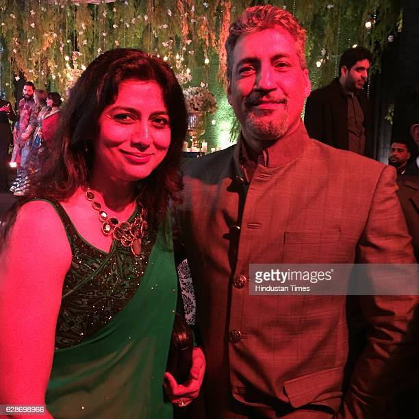 Former Indian cricketer Atul Wassan with his wife Sonu Wassan during the wedding reception of Indian Cricketer Yuvraj Singh and Bollywood actor Hazel...
