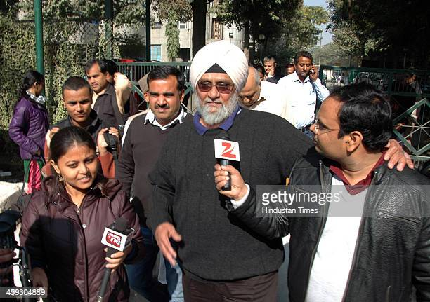 Former Indian cricketer Bishan Singh Bedi coming out after meeting with AAP leader Arvind Kejriwal at his residence on December 25 2013 in Ghaziabad...