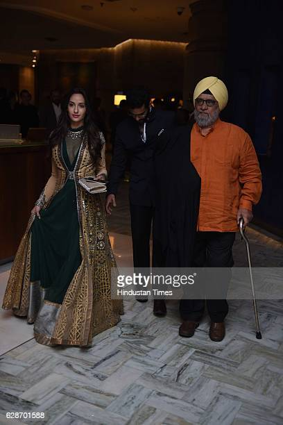 Former Indian cricketer Bishan Singh Bedi with actor Nora Fatehi during the wedding reception of Indian Cricketer Yuvraj Singh and Bollywood actor...
