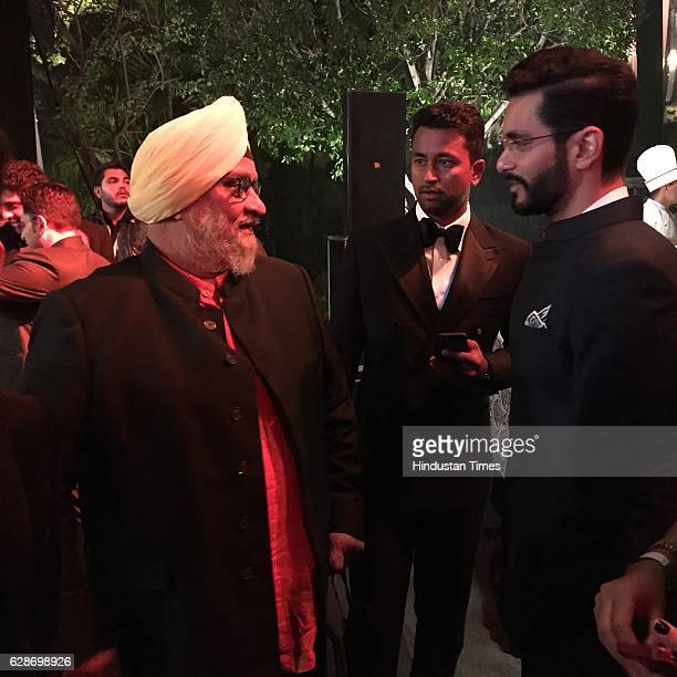 Former Indian cricketer Bishan Singh Bedi with his son and actor Angad Bedi and Cricketer Pragyan Ojha during the wedding reception of Indian...