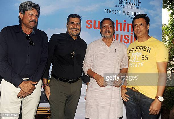 Former Indian cricketer Kapil Dev Bollywood actor Nana Patekar director Madhur Bhandarkar and producer Shailendra Singh attend the launch of the film...