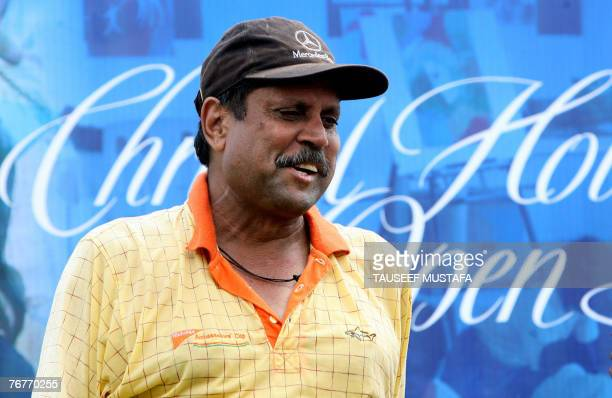 Former Indian cricketer Kapil Dev prepares to take part in The Christel House Open Golf Tournament at The Qutab Golf Club in New Delhi 15 September...