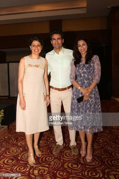Former Indian cricketer Mohammad Kaif with former Indian woMen cricketer Anjum Chopra and his wife Pooja Kaif poses for a picture during the launch...