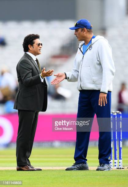 Former Indian cricketer Sachin Tendulka chats with Ravi Shastri, Indian Head Coach ahead of the resumption of the weather affected Semi-Final match...
