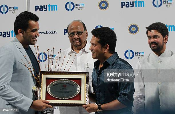 Former Indian cricketer Sachin Tendulkar congratulations Zahir Khan after his retirement after the 5th One Day International Cricket Match between...