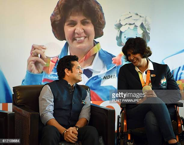 Former Indian cricketer Sachin Tendulkar interacts with Rio Paralympic Games silver medalist Deepa Malik during her felicitation ceremony in Mumbai...