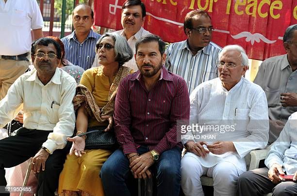 Former Indian cricketer turned commentator Arun Lal sits with social activists in support of social activist Anna Hazare who is on day three of a...