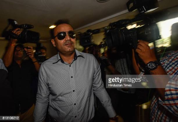 Former Indian cricketer Virender Sehwag arrives for a press conference for Indian cricket team coach at BCCI headquarters on July 10 2017 in Mumbai...