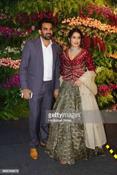 Former Indian Cricketer Zaheer Khan with wife Sagarika Ghatge during wedding reception of Virat Kohli and Anushka Sharma at St Regis Hotel Lower...