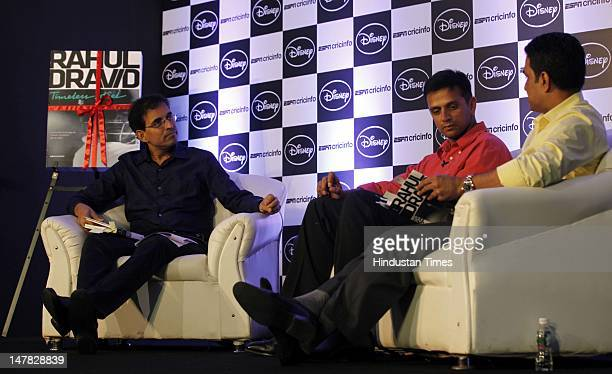 Former Indian cricketers Rahul Dravid and Sanjay Manjrekar with commentator Harsha Bhogle during the launch of 'Timeless Steel' an Anthology of...