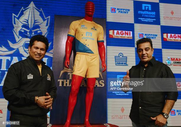 Former Indian crickter Sachin Tendulkar poses along with Indian movie actor Kamal Hassan during the launch of the 'Tamil Thalaiva' Pro Kabbadi team...