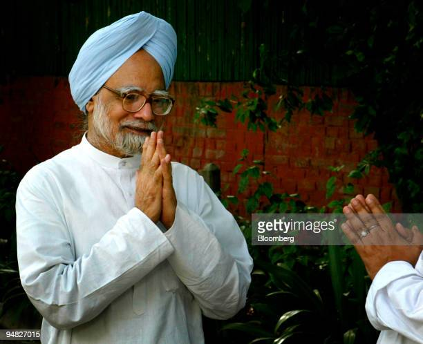 Former Indian Finance Minister and National Congress party leader Manmohan Singh welcomes guests to his residence in New Delhi, India, on Friday May...