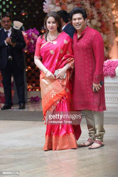 Former Indian international cricketer Sachin Tendulkar with his wife Anjali during the engagement party of Akash Ambani and Shloka Mehta at Estella...