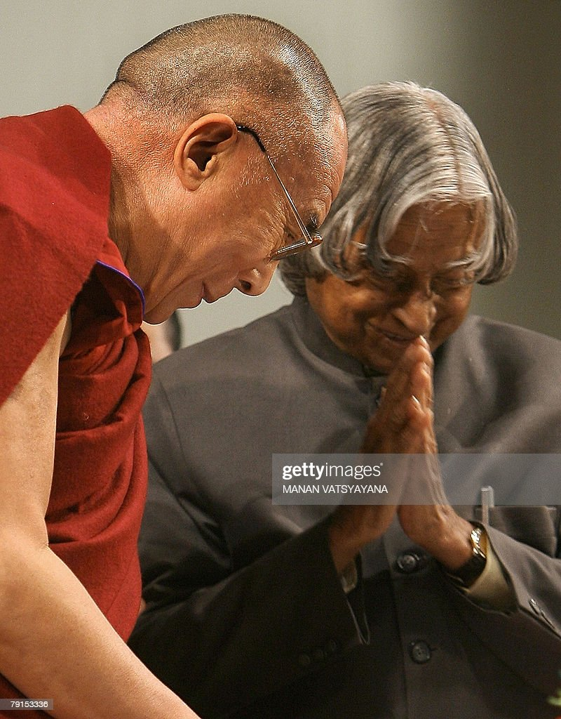 Former Indian President A.P.J.Abdul Kalam (R) gestures to exiled Tibetan spiritual leader the Dalai Lama after addressing the launch of the Global Foundation for Civilizational Harmony (India) in New Delhi, 22 January 2008. The global peace initiative aims to work for the avoidance of conflicts in various parts of the world. AFP PHOTO/ Manan VATSYAYANA