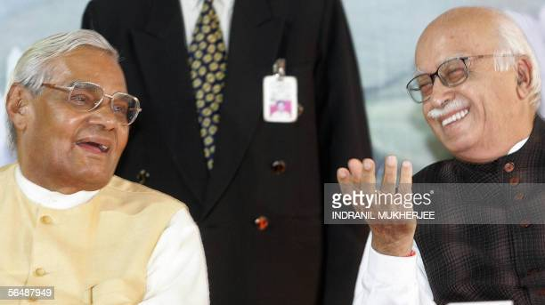 Former Indian prime minister and Bharatiya Janata Party leader Atal Behari Vajpayee and party president L K Advani laugh during a function to...