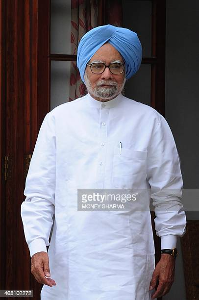 Former Indian Prime Minister Manmohan Singh arrives for the launch of an online and application based membership drive of the Congress Party in New...
