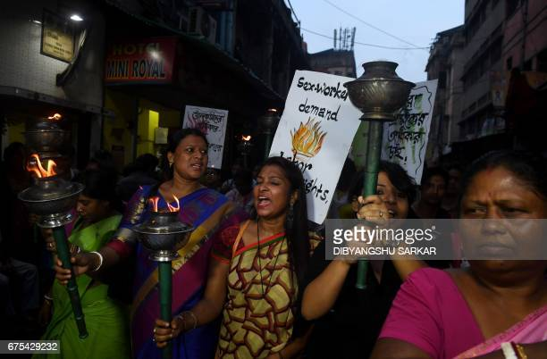 TOPSHOT Former Indian sex workers and social activists shout slogans as they participate in a May Day rally to demand their rights in Kolkata on May...