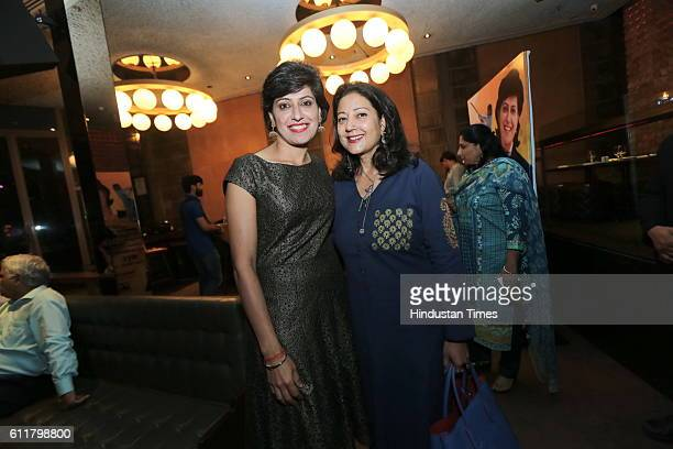 Former Indian Women Cricketer Anjum Chopra with Neelam Pratap Rudy during a facilitation program organized for her to receive honorary membership of...