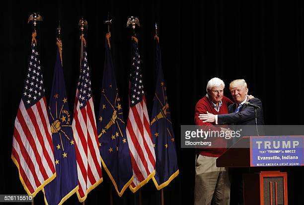 Former Indiana basketball coach Bobby Knight left embraces Donald Trump president and chief executive of Trump Organization Inc and 2016 Republican...