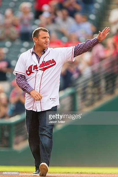 Former Indians player Jim Thome waves to fans as he walks onto the field prior to the game between the Cleveland Indians and the Tampa Bay Rays at...