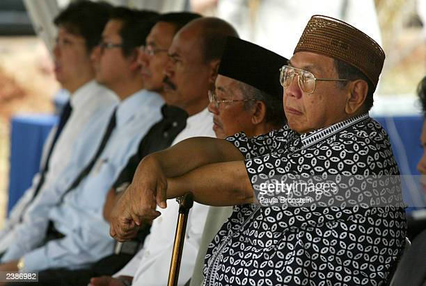 Former Indonesian President Abdurrahman Wahid attends a memorial service for victims of last week's JW Marriott Hotel bombing at the bomb site on...