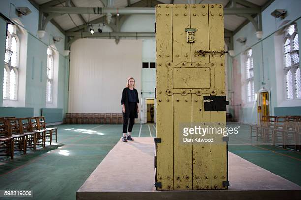 Former inmate Oscar Wilde's prison cell door is exhibited in the prison Chapel on September 1 2016 in Reading England The former Reading Prison has...